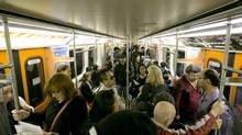 Commuters ride a TTC subway on Sept. 25, 2013. (KEVIN VAN PAASSEN/THE GLOBE AND MAIL)