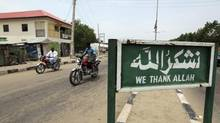An Islamic signboard is seen along a road in the northeastern Nigerian state of Borno on June 29, 2011. Northeast Nigeria has been the site of a deadly insurgency by Islamists who want to see the whole country – half of whose 170 million inhabitants are Christian – subject to sharia law. (AFOLABI SOTUNDE/REUTERS)