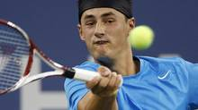 Bernard Tomic of Australia hits a return to Andy Roddick of the U.S. during their match at the US Open men's singles tennis tournament in New York, August 31, 2012. (ADAM HUNGER/REUTERS)
