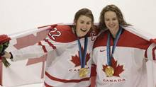 Canada's 2-0 victory over the USA in the gold medal game played at Canada Hockey Place in Vancouver during the 2010 Olympic Games. Canada's Hayley Wickenheiser , left, and Canada's Shannon Szabados. (PETER POWER/THE GLOBE AND MAIL)