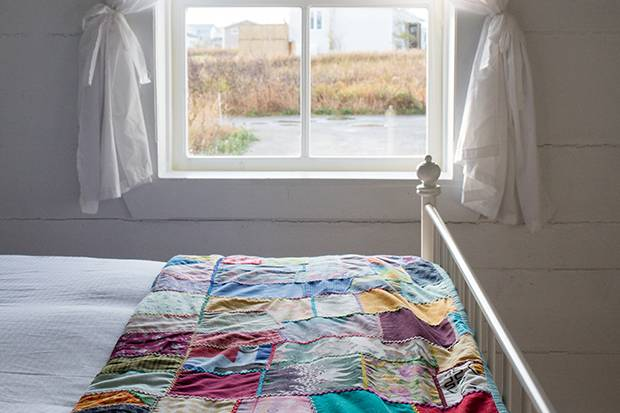 Quilts created by the Fogo Island Anglican Church Women's Group top most beds and many guests seek out their own to take home as a souvenir.