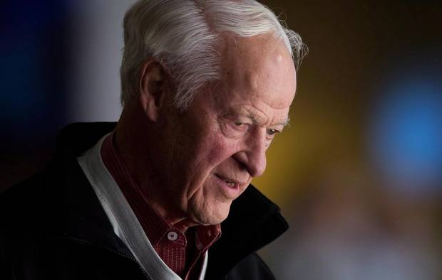 Hockey great Gordie Howe watches the Vancouver Canucks and San Jose Sharks play during an NHL hockey game in Vancouver, B.C., on November 14, 2013.