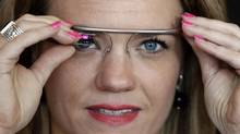Sarah Hill, a Google Glass contest winner, of Columbia, Mo. reacts while trying out her device Wednesday, May 29, 2013, in New York. (Frank Franklin II/AP)