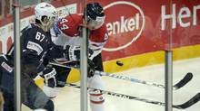 Max Pacioretty of the U.S. duels with Canada's Marc Vlasic, right, in their preliminary round match during the 2012 IIHF Ice Hockey World Championship game in Helsinki on Saturday. (LEHTIKUVA)