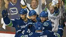 Vancouver Canucks' Mikael Samuelsson, centre, celebrates his goal against the Los Angeles Kings with teammates Daniel Sedin, Henrik Sedin and Pavol Demitra during the second period of Game 1 of their NHL Western Conference quarter-final hockey game in Vancouver. REUTERS/Andy Clark (ANDY CLARK/REUTERS)