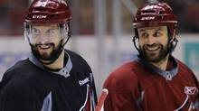 Phoenix Coyotes' Adrian Aucoin (L) and teammate Kyle Chipchura smile during their team practice in Glendale, Arizona May 14, 2012. The Coyotes are playing the Los Angeles Kings in Game 2 of the NHL Western Conference hockey finals on Tuesday. REUTERS/Todd Korol (Todd Korol/Reuters)