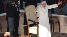 Pope Benedict XVI waves to pilgrims in St. Peter's Square at the Vatican, Feb. 27, 2013. (Luca Bruno/AP)