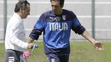 Italy coach Cesare Prandelli talks with his goalkeeper Gianluigi Buffon during a training session at the Maria Lamas Farache Stadium in Natal, Brazil on June 22. (Antonio Calanni/AP)
