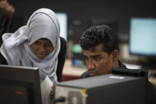 Ali Johar, right, gets some help from peer tutor Naime Mukhtar at Eastwood Collegiate Institute in Kitchener, Ont. in early November.
