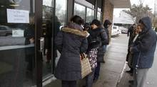 Toronto residents inquire about the availability of food cards being given to residents who lost food during the ice storm at the North York East Social Services Offices, Toronto January 2, 2014. (Fernando Morales/The Globe and Mail)