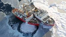 Helicopter view of Canadian Coast Guard ship Louis S. St. Laurent, left, and U.S. Coast Guard ship Cutter Healy on the Arctic Ocean. (Jessica K. Robertson/U.S. Geological Survey)