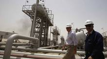Oil infrastructure in Iraq. Exxon 's signing of an oil and gas deal with the semi-autonomous Kurdistan region has drawn a sharp response from the central government in Baghdad. (ATEF HASSAN/REUTERS/ATEF HASSAN/REUTERS)