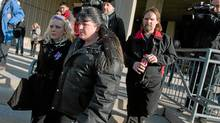 Prosecution witness Laura Perry, right, leaves court following her testimony in the Michael Rafferty murder trial in London, Ontario on March 6, 2012. (Geoff Robins/THE CANADIAN PRESS/Geoff Robins/THE CANADIAN PRESS)