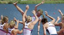 U.S. rowers throw coxswain Mary Whipple into the water after winning the gold medal for the women's rowing eight at the 2012 Summer Olympics in Eton Dorney, near Windsor, England. (Kevin Van Paassen/The Globe and Mail)