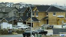 Houses under construction in Calgary are seen in this file photo. (Jeff McIntosh/Jeff McIntosh/The Globe and Mail)