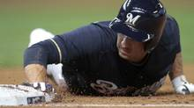 Milwaukee Brewers' Ryan Braun slides safe back to first against the St. Louis Cardinals in the fourth inning during their MLB National League baseball game in Milwaukee, Wisconsin April 7, 2012. REUTERS/Darren Hauck (Darren Hauck/Reuters)