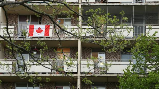 A Canadian flag flies from an apartment balcony in the Riverdale neighbourhood of Hamilton, Ont. Riverdale is a high-rise immigrant neighbourhood with the third-largest concentration of immigrants in Canada, and growing fast.