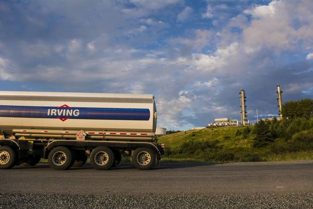 An Irving Oil truck drives past the company's refinery in Saint John in 2014.