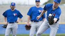 Toronto Blue Jays pitcher Casey Janssen continues his battle at spring training to avoid demotion to the minors. (file photo) (Nathan Denette/THE CANADIAN PRESS)