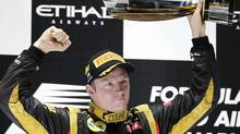 Lotus driver Kimi Räikkönen of Finland on the podium after winning the Abu Dhabi Grand Prix at the Yas Marina racetrack on Sunday, Nov. 4, 2012. (Hassan Ammar/AP)