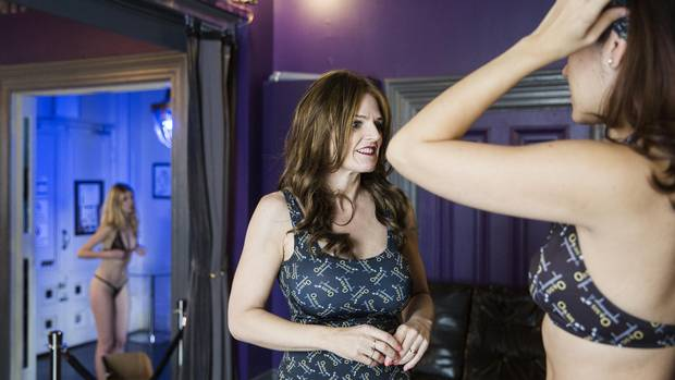 Judy Kaye talks to models during a recent branded merchandise photoshoot at Oasis Aqualounge. The 49-year-old took out $800,000 in loans with her husband to support their business six years ago.