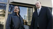 Rob Sinclair (left) , cousin of Brian Sinclair, a homeless man who died after a 34-hour wait in an emergency ward, and Vilko Zbogar, Toronto-based lawyer for the Sinclair family, are shown outside the Winnipeg Law Courts, Tuesday, Nov.17, 2009. (The Canadian Press/Mike Deal/The Canadian Press/Mike Deal)