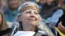 Biologist and eco-activist Alexandra Morton listens to the crowd of thousands of cheering supporters after her address during a massive rally at the BC Legislature in May 2010. (Deddeda Stemler/The Globe and Mail/Deddeda Stemler/The Globe and Mail)