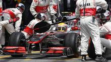 McLaren Formula One driver Lewis Hamilton of Britain waits during a pit stop during the Spanish F1 Grand Prix at Montmelo circuit, near Barcelona May 9, 2010. (ALBERT GEA/REUTERS)