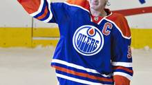 Edmonton Oilers' Ryan Smyth waves to the crowd after playing his last game in the NHL, after his retirement in Edmonton, Alta., on Saturday April 12. (JASON FRANSON/THE CANADIAN PRESS)