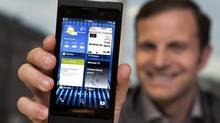 Jeff Gadway, Senior Manager in Product marketing with RIM, shows the demo product, the new Blackberry 10 at The Globe and Mail in Toronto, November 20, 2012. (Deborah Baic/The Globe and Mail)