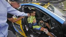 Spain's Alberto Contador is consoled after he abandoned race after crashing during the tenth stage of the Tour de France (Christophe Ena/AP Photo)