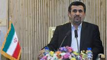 Iran's President Mahmoud Ahmadinejad speaks with journalists at Tehran's Mehrabad airport after his visit to Latin America, Jan.14, 2012. (RAHEB HOMAVANDI/REUTERS)