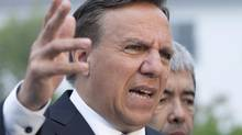Coalition Avenir Quebec Leader Francois Legault responds to questions at a news conference Wednesday, August 15, 2012 in Riviere-du-Loup, Que. (Jacques Boissinot/THE CANADIAN PRESS)