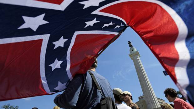 Protesters calling for the removal and the preservation of Confederate-era monuments face off in dueling demonstrations, Sunday, May 7, 2017, in New Orleans.