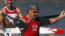 Adam Van Koeverden (front) of Canada celebrates winning the men's K1 1000m final during the ICF Canoe and Kayak Sprint World Championships in Szeged, 170km (106 miles) south of Budapest, August 19, 2011. REUTERS/Laszlo Balogh (LASZLO BALOGH)