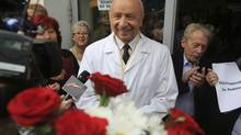 "Professor Bogdan Chazan speaks to the media among his supporters in front of a maternity hospital in Warsaw June 13, 2014. In April this year, a pregnant woman asked Chazan, director of Warsaw's Holy Family Hospital, for an abortion because her own physician had diagnosed her unborn child with grave health problems. Chazan sent the woman a letter saying he could not agree to an abortion in his hospital because of a ""conflict of conscience,"" and instead gave the woman the address of a hospice where, he said, the child could get palliative care once born. (AGENCJA GAZETA/REUTERS)"