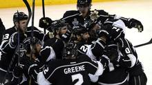 Los Angeles Kings right wing Justin Williams (14) is congratulated by teammates after scoring the game-winning goal in the overtime period of Game 1 of the 2014 Stanley Cup Final against the New York Rangers at Staples Center. (USA TODAY Sports)