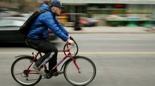 A cyclist rides in downtown Toronto. (DAVE CHAN/Dave Chan for The Globe and Mail)