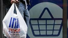 A customer leaves a Tesco supermarket in London in this file photo. Consumer prices in the euro zone fell to 0.7 per cent year-over-year in January, 2014, down from 0.8 per cent in December. (Luke MacGregor/Reuters)
