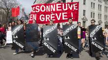 "Students carrying signs gather to protest against tuition hikes in downtown Montreal, Quebec March 22, 2012. The banner in red reads ""Maisonneuve on strike."" (Christinne Muschi/Reuters/Christinne Muschi/Reuters)"