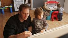 Sports artist Robb Scott shares some drawing time with his sons Griffin, 4, and Turner, 2, at his home in Greenfield, N.S. (PAUL DARROW FOR THE GLOBE AND MAIL)