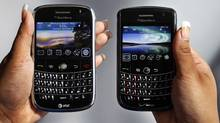 A BlackBerry Bold, left, and a Blackberry Tour, made by Research In Motion Inc. (Paul Sakuma)