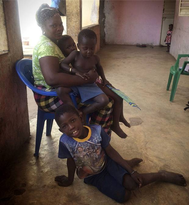 Yessa Camara, 30, shown with her nephews and nieces, has a husband in Spain who sends money back to Senegal to support her and the family's children.