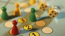 Close-up of ludo boardgame with dice. Shot in studio with Phase One. (Claudiobaba)