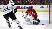 Dallas Stars left wing Antoine Roussel has his shot blocked by Washington Capitals goalie Jaroslav Halak in the second period of an NHL hockey game, Tuesday, April 1, 2014, in Washington. (Associated Press)