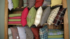 Elegant tartan and tweed cushions and throws are on offer at ANTA.