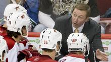 Former Phoenix Coyotes head coach Wayne Gretzky talks to his players during a timeout. (ANDY CLARK)