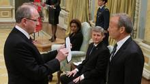 Stockwell Day is sworn in as President of the Treasury Board and Minister for the Asia-Pacific Gateway at Rideau Hall as Prime Minster Stephen Harper looks on in Ottawa on Tuesday, Jan. 19, 2010. (Fred Chartrand/THE CANADIAN PRESS/Fred Chartrand)