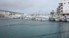 Fishing boats are moored at Tomari port in Naha on Japan's southern island of Okinawa as super typhoon Neoguri approaches the region on July 7, 2014. (KYODO/REUTERS)