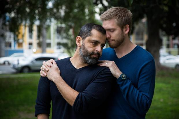 Santos Reyes, left, and his partner Trevor Carter in Sacramento, California, on Jan. 18, 2018. The couple just moved from Texas so Reyes can avoid possible deportation to El Salvador.